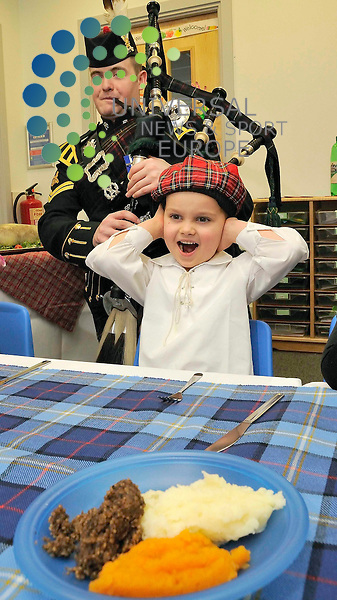 "Pictured Jacob Powszeck(4) with Corporal Andy Reid, a piper with The Highlanders, 4th Battalion, Royal Regiment of Scotland (4 SCOTS) will face one of the toughest challenges of his Army and piping career when he pipes in the haggis for young children at The Waterfront Nursery at Edinburgh's Telford College, for the Nursery's very own Burns Supper.. ..More accustomed to playing for troops in Afghanistan, Iraq and Bosnia as well as performing the Royal Guard for the Queen at Balmoral Castle, Corporal Reid will give nursery school children a real taste of an authentic Burns Supper as he pipes in the haggis for the children's lunch.. .Lynn Muir, Waterfront Nursery Manager, explained:  ""The children and staff are so much looking forward to having a real piper come and perform to us for the children's Burns Supper.  We've never had a piper perform before and we're honoured to have such a well respected piper and soldier come and play for us on this very special occasion.  We'll be reciting Burns poems throughout the day and we'll have the nursery decorated accordingly.  The children are all very excited about the day and are looking forward to their haggis, neeps and tatties, as well as hearing the pipe music.. .""Additionally, one of the Performing Arts students at Edinburgh's Telford College has agreed to give the Address to a Haggis, something the children won't have heard before, but something that will give the occasion a real Burns feel."". .Corporal Andy Reid, stated:  ""I've been in the Army for nearly ten years and I can say without doubt, this is one of the toughest challenges I've had to face.  I've been on tours with 4 SCOTS to Bosnia, Iraq and most recently to Afghanistan and nothing can prepare me for what I'm about to do at the Waterfront Nursery.  Joking aside, I'm delighted to have been asked to perform at the Nursery to hopefully give the children a day they'll remember and in a first, it's definitely the youngest audience I've ever played in front of."".Pi"
