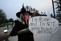 Phoenix, Arizona (February 25, 2014) - A demonstrator dressed as a witch with a cutout photograph of Arizona governor Jan Brewer covering her face holds a sign expressing her opinion on a possible veto to the SB 1062 bill. Arizona's Senate Bill 1062 is galvanizing the LGBT community and other civil and religious groups in the state. A crowd rallied in front of Arizona's Capitol in Phoenix to continue pressuring governor Jan Brewer to veto what they call a discriminatory bill. If approved, SB1062 would amend the existing Religious Freedom Restoration Act, which will allow business owners to deny service to gay and lesbian customers so long as proprietors were acting solely on their religious beliefs. As of this protest, the SB1062 is on Brewer's desk awaiting her approval or veto. Photo by Eduardo Barraza © 2014