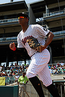 Birmingham Barons left fielder Eloy Jimenez (21) runs out of the dugout to start a game against the Pensacola Blue Wahoos on May 9, 2018 at Regions FIeld in Birmingham, Alabama.  Birmingham defeated Pensacola 16-3.  (Mike Janes/Four Seam Images)