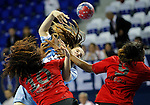 Argentinaís Natalia Vico (C) vies with Angolaís Juliana Jose Machado (L) and Isabel Sambovo Fernandes (R) during their Women's Handball World Championship 2013 match Angola vs Argentina on December 7, 2013 in Zrenjanin.   AFP PHOTO / PEDJA MILOSAVLJEVIC