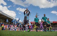 Joe Jacobson of Wycombe Wanderers applauds the supporters as he leads the team onto the pitch during the Sky Bet League 2 match between Wycombe Wanderers and Plymouth Argyle at Adams Park, High Wycombe, England on 12 September 2015. Photo by Andy Rowland.