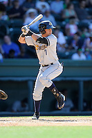 Designated hitter Angel Aguilar (7) of the Charleston RiverDogs bats in a game against the Greenville Drive on Sunday, June 28, 2015, at Fluor Field at the West End in Greenville, South Carolina. Charleston won, 12-9. (Tom Priddy/Four Seam Images)