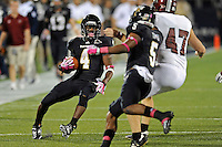 25 October 2011:  FIU wide receiver T.Y. Hilton (4) returns a punt 33 yards to the Troy 21 yard line to set up the game tying field goal in the fourth quarter as the FIU Golden Panthers defeated the Troy University Trojans, 23-20 in overtime, at FIU Stadium in Miami, Florida.