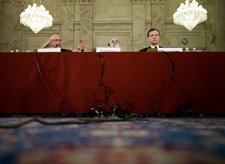 "WASHINGTON, DC - Feb. 14: Treasury Secretary Henry M. Paulson Jr., Federal Reserve Chairman Ben S. Bernanke and SEC Commissioner Christopher Cox during the Senate Banking hearing on the U.S. economy. As a way to help revive the struggling housing market, Bernanke called on Congress to pass legislation to modernize the Federal Housing Administration and overhaul regulation of mortgage giants Fannie Mae and Freddie Mac. So far, lawmakers have been unable to clear legislation that would overhaul FHA, an agency created during the Depression that helps home buyers obtain affordable mortgages by insuring the loans. Lawmakers are working to reconcile House- and Senate-passed overhaul bills (HR 1852, S 2338). ""The FHA provides an opportunity to refinance troubled borrowers into more stable, long-term . . . mortgages,"" Bernanke said at a hearing before the Senate Banking, Housing and Urban Affairs panel. (Photo by Scott J. Ferrell/Congressional Quarterly)"