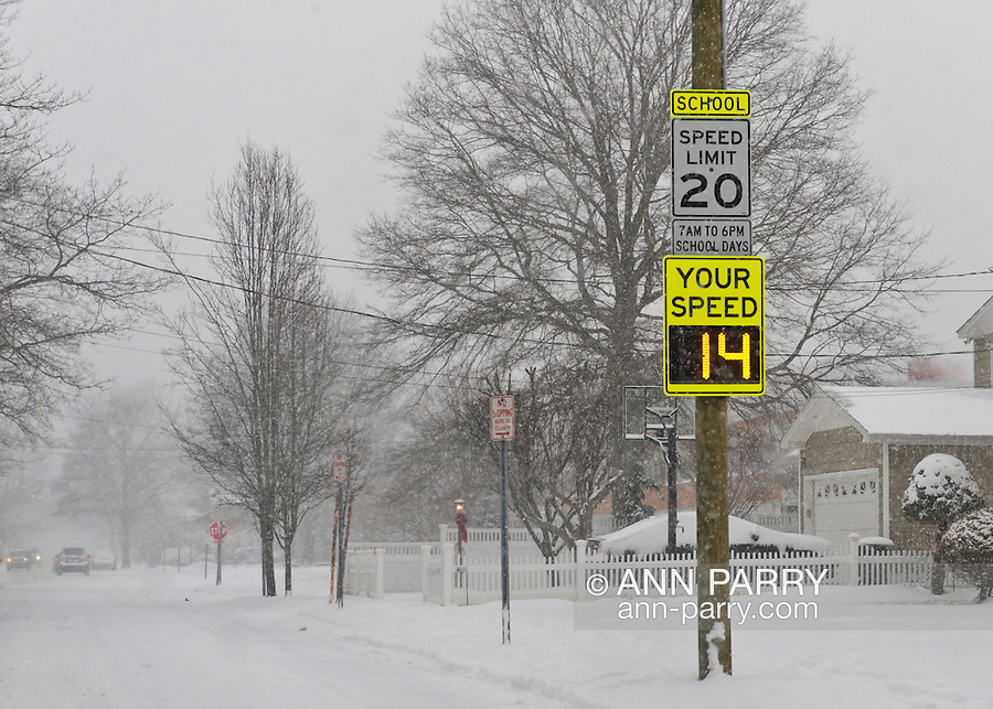 Merrick, New York, U.S. January 21, 2014. An electric sign states that a car is going 14 mph, which is well below the 20 miles speed limit, as snow falls heavily on Long Island. Governor Cuomo declared a state of emergency due to the snow storm, with up to 10 inches of snow expected. Radar automatically determines the speed of oncoming cars during school hours in this school zone.