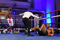 Denzel Bentley (white/red shorts) defeats Ashley Bailey Dumetz during a Boxing Show at the Camden Centre on 10th March 2018