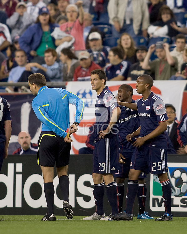 Stunned red card recipient New England Revolution midfielder Marko Perovic (29) watches as referees pockets the red card. Chivas USA defeated the New England Revolution, 4-0, at Gillette Stadium on May 5, 2010.