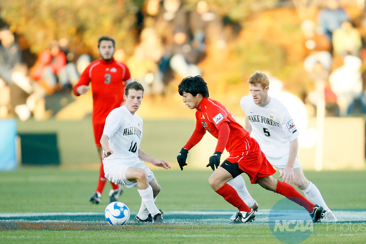 16 DEC 2007:  Forward Roger Espinoza (27) of Ohio State University tries to avoid the defense of Patrick Phelan (5) and Corben Bone(10) of Wake Forest University during the Division I Men's Soccer Championship held at the SAS Soccer Park in Cary, NC.  Wake Forest defeated Ohio State 2-1 for the national title.  Jamie Schwaberow/NCAA Photos