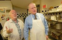Montreal, October 27th 2001<br /> <br /> &quot;Dans la rue&quot; founder father Emmett Johns a.k.a. &quot;Pops&quot; (L) gives a guided tour of the   kitchen to  Andr&Egrave; Caill&Egrave; (R ); president and CEO of Hydro Quebec  and honorary chairman of  it's 2001 fundraising campaign, at the organization headquarters located at 1664 Ontario East, in Montreal, CANADA, on Tuesday, November 27.<br /> <br /> Caill&Egrave; served lunch to the young people who use the day centre and those who stop by.<br /> <br /> &quot;Dans la rue&quot;, an organization founded in 1988 by father Emmett Johns a.k.a. &quot;Pops&quot; is well known for the services offered by the Roulotte, an emergency shelter and day centre. . This year's goal is to raise $2.5 million to help Montreal's 5,000 young homeless people<br /> throughout the year.<br /> <br /> <br /> Photo by Sevy-IMAGES DISTRIBUTION <br /> <br /> NOTE :  D-1 H original JPEG, saved as Adobe 198 RGB