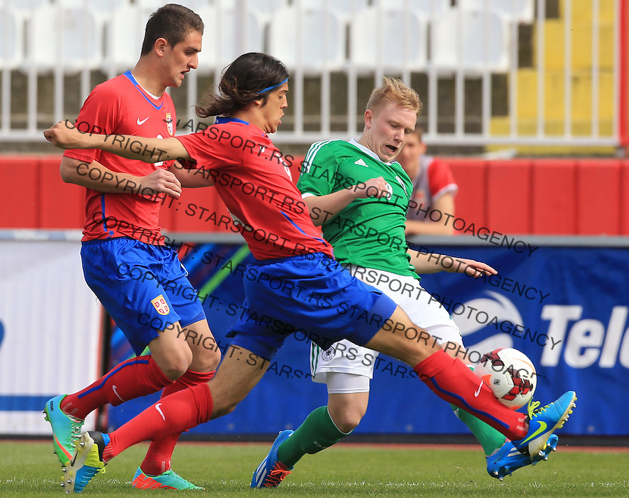 Fudbal UEFA U17 Elite round<br /> Srbija v Nemacka<br /> Phillipp Ochs (R) Lazar Zlicic (C) and Marko Mijailovic<br /> Novi Sad, 03.31.2014.<br /> Foto: Srdjan Stevanovic/Starsportphoto.com&copy;