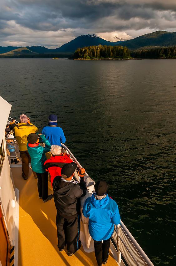 Passengers aboard the Wilderness Explorer whale watching, Port Houghton, near Frederick Sound,  Inside Passage, Southeast Alaska USA.