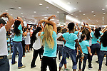"Flash Mob dance event for Estée Lauder at Macy's in Long Island, New York, USA, on July 23, 2011. Teal shirts dancers wearing have ""Imagine having nothing to hide"" written on front."