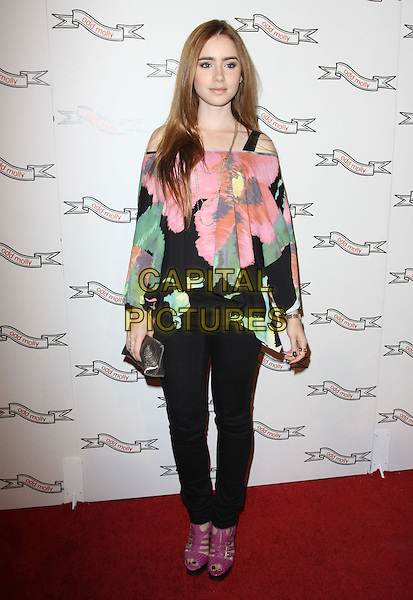 LILY COLLINS .Odd Molly Flagship Store Opening held At Odd Molly Boutique, Beverly Hills, California, USA, 19th March 2010..full length pink green flower floral print floaty top off the shoulders jeans purple shoes cut out sandals platform silver clutch bag .CAP/ADM/KB.©Kevan Brooks/AdMedia/Capital Pictures.