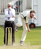James Baker of North London bowls during the Middlesex County Cricket League Division Three game between Highgate and North London at Park Road, Crouch End on Sat July 12, 2014