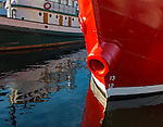 Seattle, Washington:<br /> Red bow of the lightship Swiftsure and reflecting tug Arthur Foss on Lake Union, Northwest Seaport