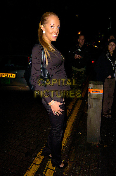 AISLEYNE HORGAN-WALLACE.At the Adee Phelan Hairdressing Salon Launch, Covent Garden, London, England..November 27th 2007.full length black trousers shirt bag purse .CAP/CAN.©Can Nguyen/Capital Pictures