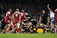 Referee Pascal Gauzere awards a penalty to Georgia after a strong scrum. Rugby World Cup Pool C match between New Zealand and Georgia on October 2, 2015 at the Millennium Stadium in Cardiff, Wales. Photo by: Patrick Khachfe / Onside Images