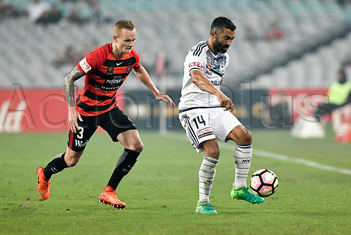 April 8th 2017, ANZ Stadium, Sydney, Australia; A-League football, Western Sydney Wanderers versus Melbourne Victory; Victory forward Fahid Ben Khalfallah is marked closely by Wanderers defender Jack Clisby; The match  ended in a 0-0 draw;