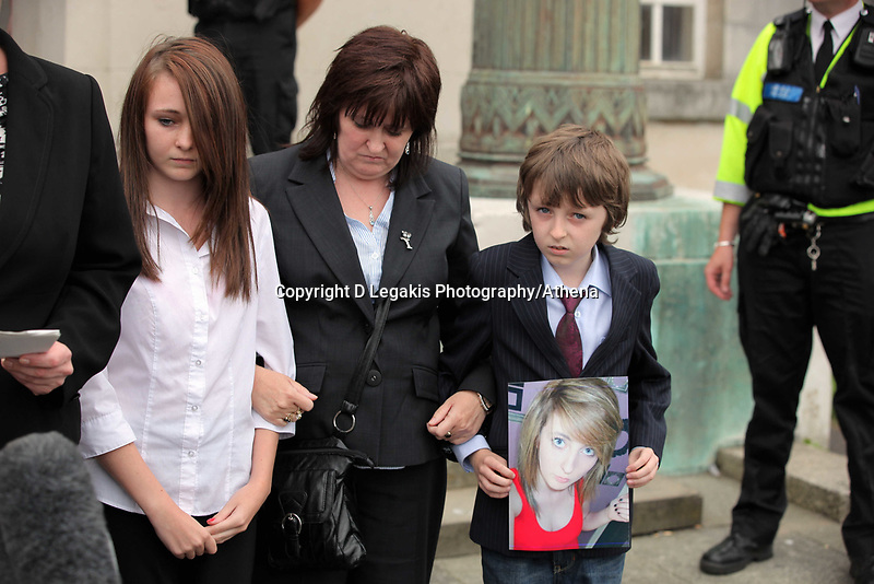 Pictured: The mother (C) Sonia of tragic teen Rebeca Aylward with her other daughter and son Jack (R) who is holding a picture of Rebecca, standing outside Swansea Crown Court while a staement is being read on their behalf. Wednesday 27 July 2011<br />