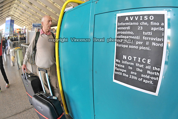 Rome, Italy - April 19, 2010  A traveller inquires an automated tickets issuer in Termini train station during the air transport crisis caused by the eruption of a volcano in Iceland.