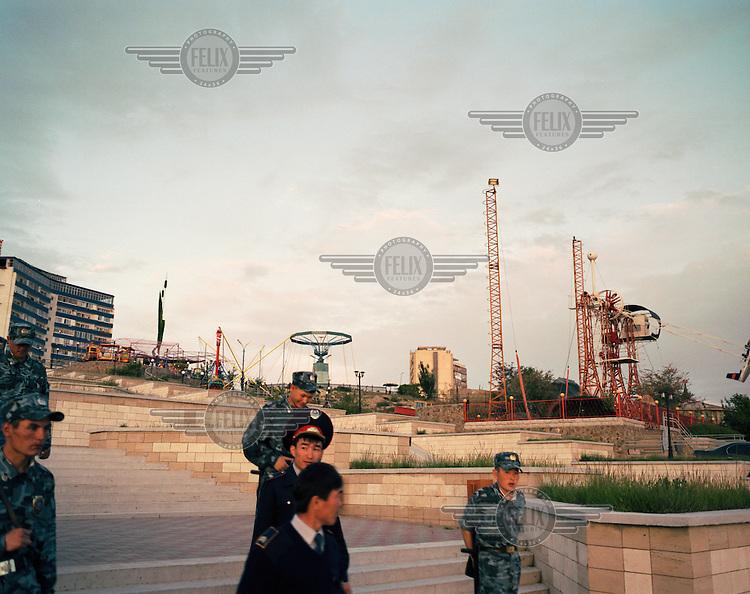 Military guards walk past a fair ground complex in the coastal city of Aktau.