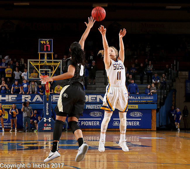 BROOKINGS, SD - MARCH 19:  Madison Guebert #11 from South Dakota State spots up for a jumper over Quinessa Caylao-do #0 from Colorado during their second round WNIT game at Frost Arena March 19, 2017 in Brookings, South Dakota. (Photo by Dave Eggen/Inertia)