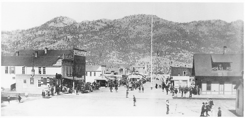 Looking down street from railroad.  Crowd and &quot;Welcome&quot; arch.  Railroad depot on right.<br /> D&amp;RG  possibly Buena Vista, CO