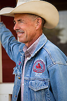 Murray Thompson, World Champion Reined Cow Horse on his ranch in California wearing denim jacket with national champion embroidery