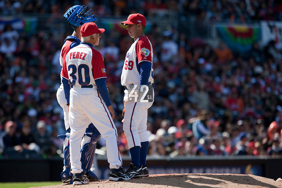 15 March 2009: #30 assistant coach Pedro Perez of Cuba talks to pitcher #59 Ismel Jimenez during the 2009 World Baseball Classic Pool 1 game 1 at Petco Park in San Diego, California, USA. Japan wins 6-0 over Cuba.