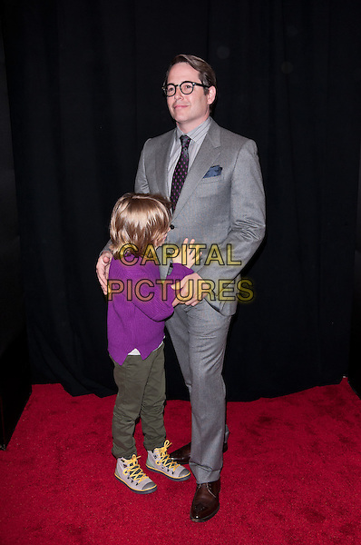 James Wilkie Broderick & Matthew Broderick.'Tower Heist' New York Premiere, New York City, NY, USA..October 24th, 2011.full length  pink purple top holding hands green trousers grey gray suit glasses father son dad family holding hands profile hiding shy.CAP/ADM/CS.©Christopher Smith/AdMedia/Capital Pictures.