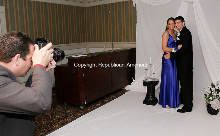 ORANGE, CT, 05/15/09- 051509BZ11- Photographer Dave Hughes, owner of Rockwell Studios, takes a portrait of Oxford High junior Jackie Morrissey, 17, of Oxford, and Josh Calbanese, 18, of Oxford, a senior at Seymour High School, at the Oxford High School junior prom at the Grassy Hill Country Club in Orange Friday night. <br /> Jamison C. Bazinet Republican-American