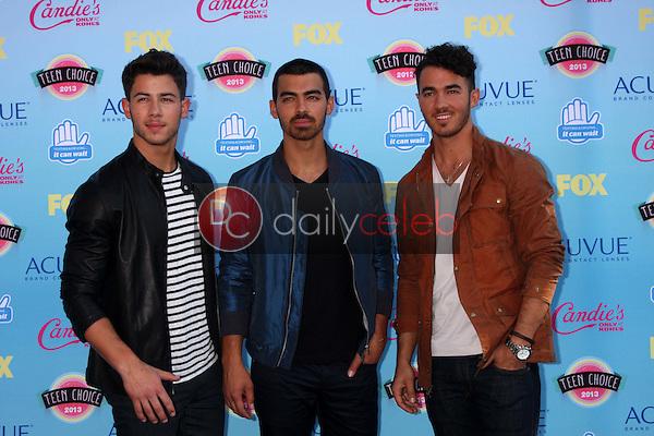 Nick Jonas, Joe Jonas, Kevin Jonas<br /> at the 2013 Teen Choice Awards Arrivals, Gibson Amphitheatre, Universal City, CA 08-11-13<br /> David Edwards/Dailyceleb.com 818-249-4998