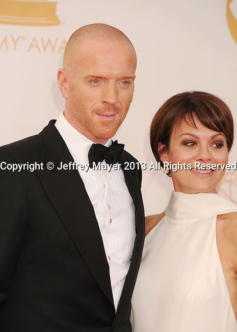 LOS ANGELES, CA- SEPTEMBER 22: Actor Damian Lewis (L) and Helen McCrory arrive at the 65th Annual Primetime Emmy Awards at Nokia Theatre L.A. Live on September 22, 2013 in Los Angeles, California.