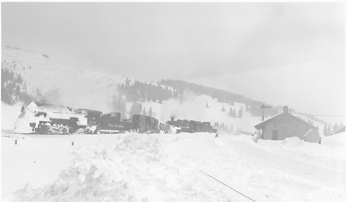 K-36 #483 with Jordan spreader turn assisted by #487 on the Cumbres snowshed lead.<br /> D&amp;RGW  Cumbres, CO  Taken by Richardson, Robert W. - 1/21/1949