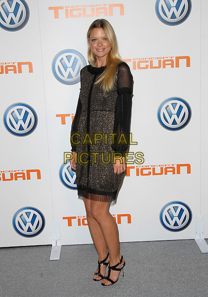 JAIME KING.attends Volkswagen US Premiere of Concept Tiguan held at Raleigh Studios in Los Angeles, California, USA,.November 28, 2006..full length black sparkly glittery dress t-bar strappy sandals shoes jamie.CAP/DVS.©Debbie VanStory/Capital Pictures
