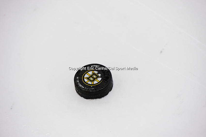 September 15, 2017: A Bruins practice puck sits on the ice during the Boston Bruins training camp held at Warrior Ice Arena in Brighton, Massachusetts. Eric Canha/CSM