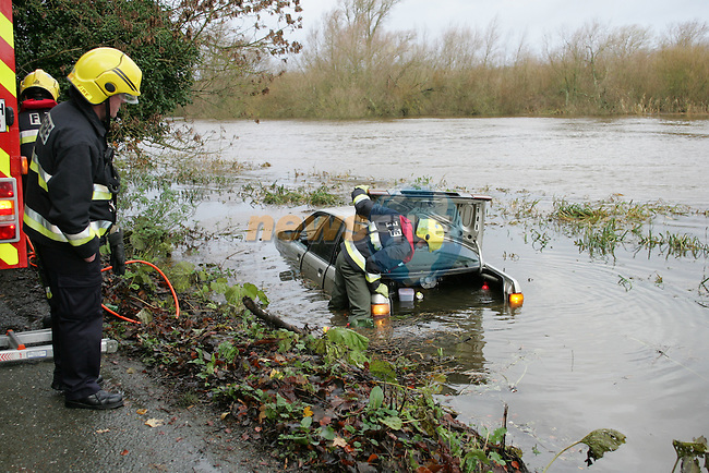 The sunken Audi car in the river Boyne on Sunday Morning. The occupants of the foreign registered car escaped through the passenger window after breaking the glass, the car was nearly fully submerged, the Rescue unit from the Drogheda fire service used cutting equipment to open the booth to check that there was nobody or anything trapped inside..Photo: Fran Caffrey/ Newsfile.<br />