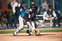 Scott Combs (11) of Divine Child High School in Northville, Michigan during the Under Armour All-American Pre-Season Tournament presented by Baseball Factory on January 14, 2017 at Sloan Park in Mesa, Arizona.  (Mike Janes/MJP/Four Seam Images)