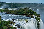 Iguazu Falls National Park in Argentina and Brazil.  A UNESCO World Heritage Site.  In the foreground is the top of the Santa Maria Waterfall, with the Devil's Throat or Garganta del Diablo with its mist plume just visibe above at left.