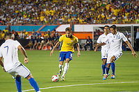 Miami, FL - Saturday, Nov 16, 2013: Brazil vs Honduras during an international friendly at Miami's Sun Life Stadium. Brazilian Neymar is chased by Honduras defenders.