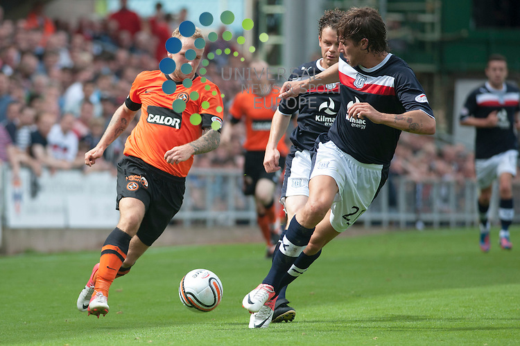Johnny Russell of Dundee Utd runs at Davide Grassi and Matthew Lockwood of Dundee...Dundee Utd v Dundee at Tannadice on Sunday 19th August.