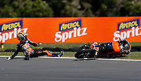 KTM Moto3 rider Zulfahmi Khairuddin of Malaysia slides off his bike during qualifying session at the Australian Motorcycle GP in Phillip Island, Oct 19, 2013. Photo by Daniel Munoz/VIEWpress IMAGE RESTRICTED TO EDITORIAL USE ONLY- STRICTLY NO COMMERCIAL USE.