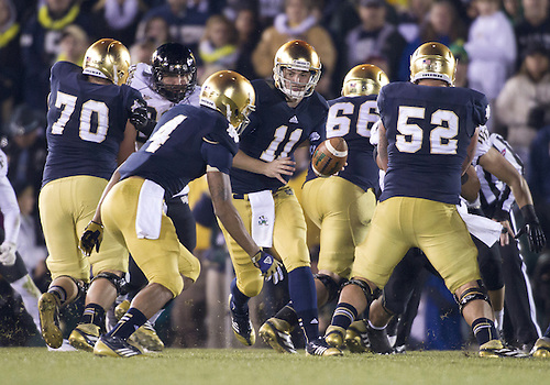 November 17, 2012:  Notre Dame quarterback Tommy Rees (11) hands the ball off during NCAA Football game action between the Notre Dame Fighting Irish and the Wake Forest Demon Deacons at Notre Dame Stadium in South Bend, Indiana.  Notre Dame defeated Wake Forest 38-0.
