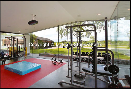 BNPS.co.uk (01202 558833)<br /> Pic: Jackson-Stops&Staff/BNPS<br /> <br /> Gym with drop down cinema and surround sound.<br /> <br /> For sale - Super home with its own leisure centre attached.<br /> <br /> The buyers of this stunning country property will never need to leave home again - with their own leisure complex at their fingertips.<br /> <br /> Birchwood House in Hoar Cross, Staffs, is a bespoke five-bedroom house that makes the most of the incredible countryside surrounding it with floor to ceiling windows in most rooms.<br /> <br /> But the really unusual selling feature is its unsurpassed leisure suite with a purpose-built gym, 15-metre swimming pool, sauna and steam room. <br /> <br /> It might save you a fortune in gym fees, but any wannabe owners will need £2.75million to get their hands on this cutting edge, contemporary pad.<br /> <br /> The house also has a media room which currently has a pool table and a home cinema, meaning you really could settle in for the long haul.