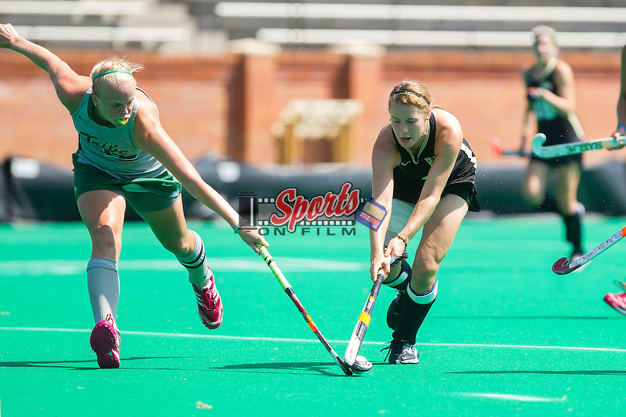 Christine Conroe (4) of the Wake Forest Demon Deacons battles for the ball with Jesse Ebner (10) of the William & Mary Tribe at Kentner Stadium on September 15, 2013 in Winston-Salem, North Carolina.  The Demon Deacons defeated the Tribe 4-0.  (Brian Westerholt/Sports On Film)