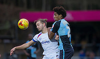 Adam McGurk of Portsmouth & Sido Jombati of Wycombe Wanderers go for the ball during the Sky Bet League 2 match between Wycombe Wanderers and Portsmouth at Adams Park, High Wycombe, England on 28 November 2015. Photo by Andy Rowland.