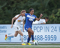 Boston Breakers forward Sydney Leroux (2) dribbles down the wing as Western New York Flash forward Adriana Martin (8) pressures. In a National Women's Soccer League (NWSL) match, Boston Breakers (blue) tied Western New York Flash (white), 2-2, at Dilboy Stadium on August 3, 2013.