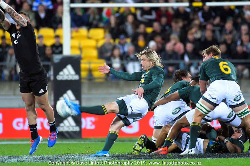 South Africa's Faf de Klerk clears under pressure from NZ's TJ Perenara during the Rugby Championship rugby union match between the New Zealand All Blacks and South Africa Springboks at Westpac Stadium in Wellington, New Zealand on Saturday, 27 July 2019. Photo: Dave Lintott / lintottphoto.co.nz