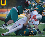 SPEARFISH, SD - NOVEMBER 23, 2013:  Brett Arrivey #6 of Black Hills State gets sandwiched between Black Hills State tacklers during their game Saturday at Lyle Hare Stadium in Spearfish, S.D. Black Hills State won 50-48 in triple overtime.  (Photo by Dick Carlson/Inertia)