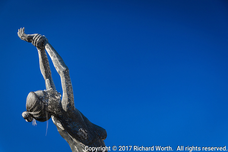 "With arms raised and looking skyward, a close-up view of the ""Truth is Beauty"" sculpture at the San Leandro Tech Center."